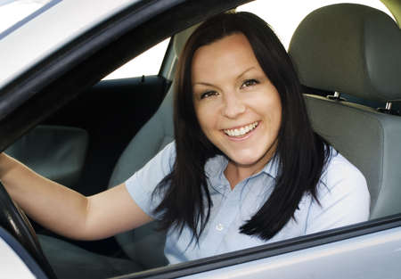 smiling woman driving car Stock Photo