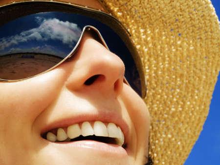 woman in sunhat on the blue sunny sky