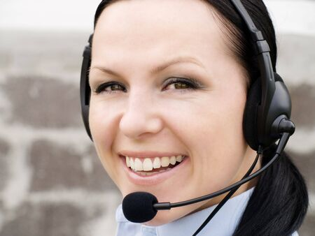 smiling brunette woman with headphone photo