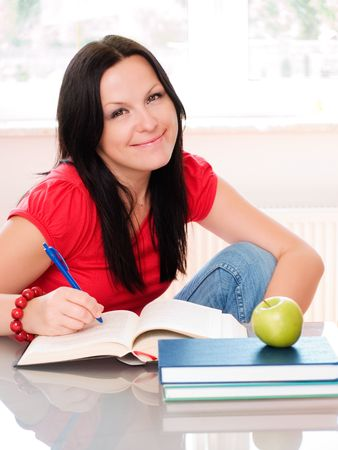 smiling brunette woman studying photo