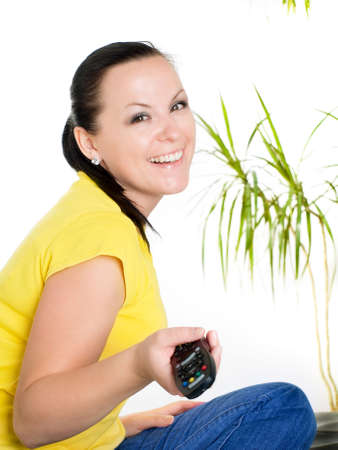 smiling brunette woman watching tv photo