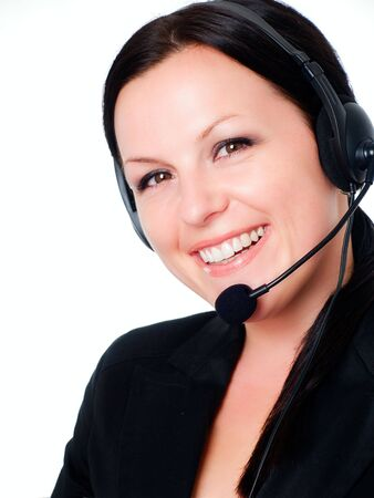 smiling brunette woman talking by headphone photo