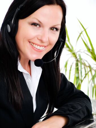 smiling brunette woman with headphone in office photo