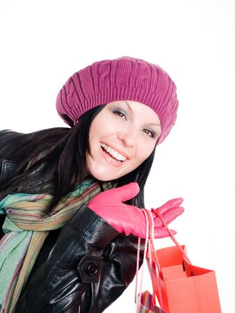 smiling brunette woman in fall clothes holding shopping bags photo