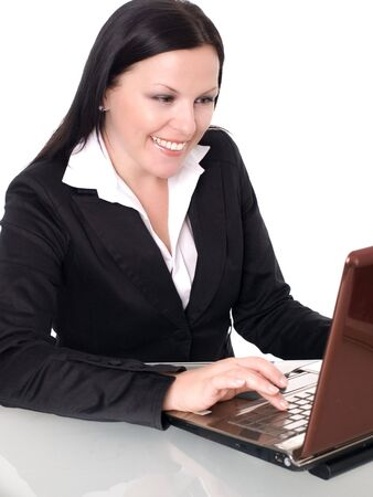 smiling brunette businesswoman in office with laptop Stock Photo - 5595399
