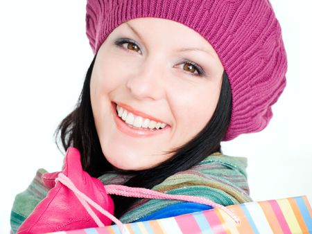 closeup of smiling brunette woman in fall clothes holding shopping bags
