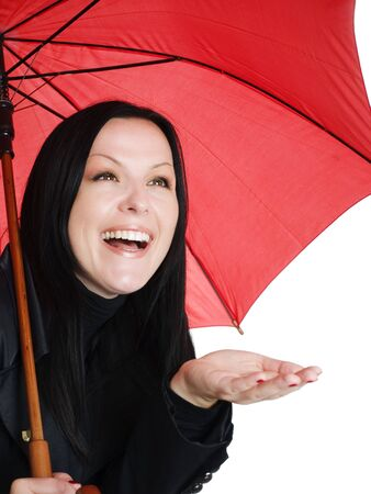 smiling brunette woman in fall, rainproof clothes holding umbrella photo
