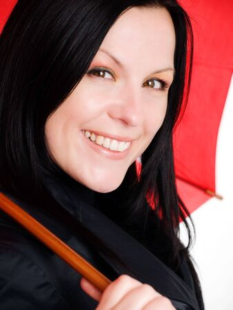 closeup of smiling brunette woman in fall clothes holding umbrella Stock Photo - 5675784