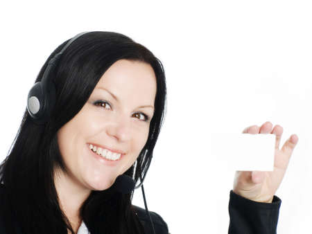 smiling brunette woman with headphone holding businesscard photo