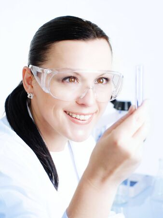 Closeup of a female researcher holding up a test tube Stock Photo - 5705924