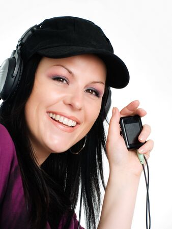 closeup of smiling woman with headphones and mp3 listening music Stock Photo - 5789682