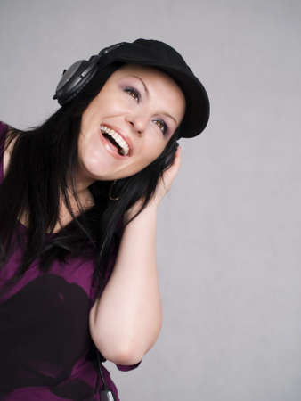 smiling woman with headphones listening music Stock Photo - 5789684