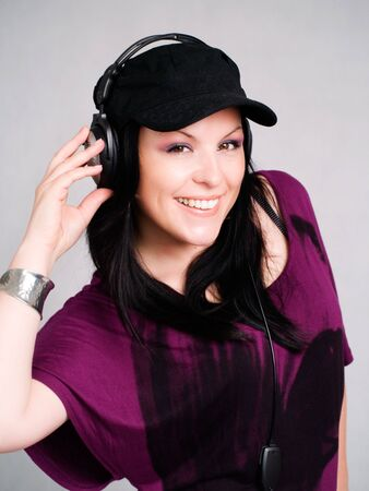 smiling woman with headphones listening music Stock Photo - 5789683