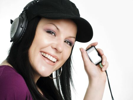 closeup of smiling woman with headphones and mp3 listening music Stock Photo - 5789685