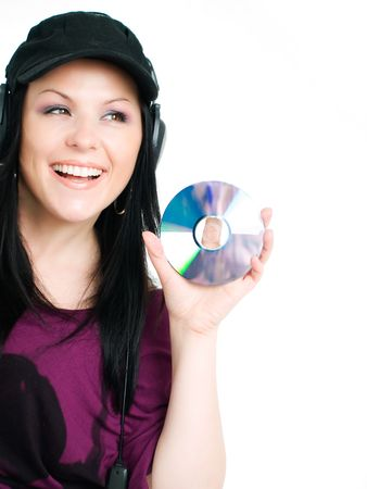 smiling woman with headphones holding cd Stock Photo - 5789672
