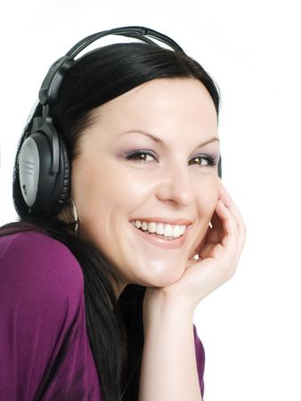 closeup of smiling beautiful woman with headphones listening music Stock Photo - 5789671