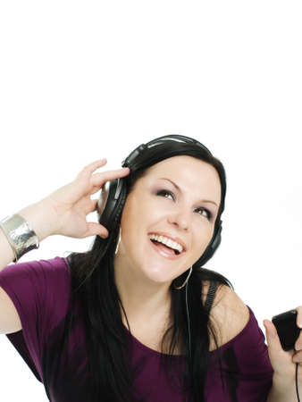 smiling woman with headphones and mp3 listening music Stock Photo - 5789681