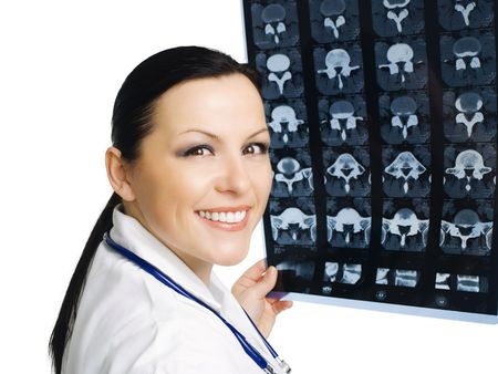 Portrait of female doctor examining x-ray picture Stock Photo