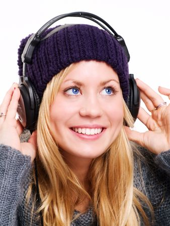 closeup of smiling beautiful teenager with headphones listening music Stock Photo