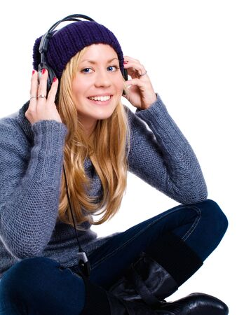 smiling blond woman with headphones listening music over white Stock Photo - 5841398