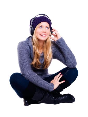 smiling blond woman with headphones listening music over white Stock Photo - 5841403