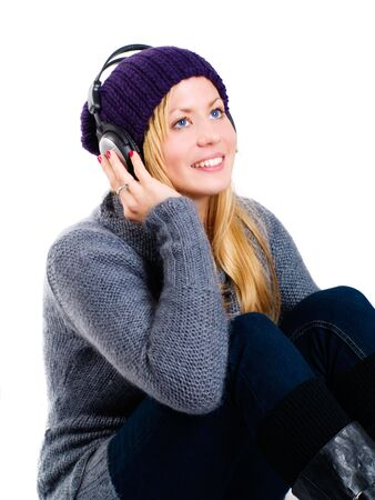 smiling blond woman with headphones listening music over white Stock Photo - 5841380