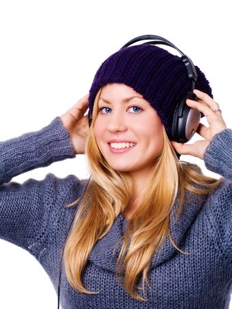 smiling blond woman with headphones listening music over white Stock Photo - 5841391