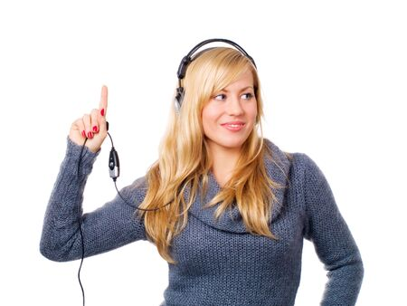 smiling young woman with headphones pointing upwards over white Stock Photo - 5841384