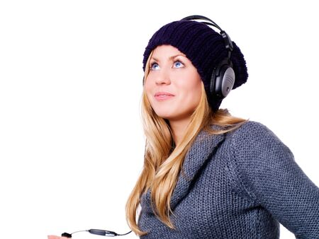 smiling blond woman with headphones listening music over white Stock Photo - 5841399