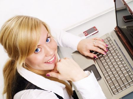 smiling blond woman working with computer in office Stock Photo - 5899461