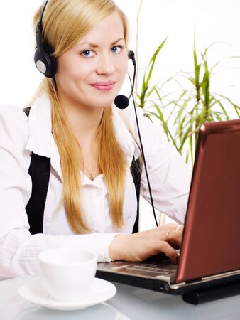 smiling blond woman with headphone in office Stock Photo - 5899452