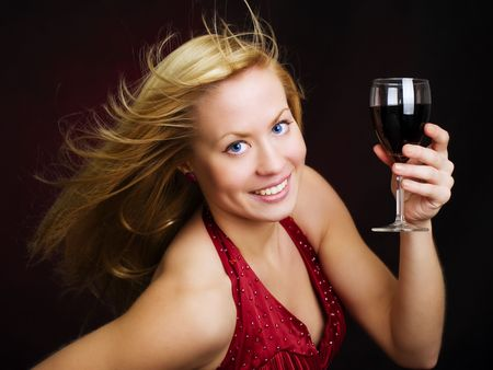 smiling beautiful woman holding wine and celebrating new year photo