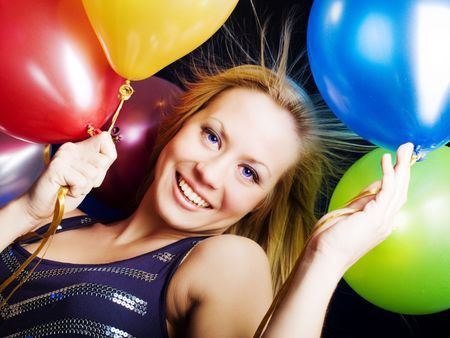 smiling woman holding ballons and celebrating Stock Photo