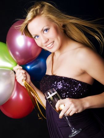 smiling blond woman holding ballons and champagne Stock Photo - 6102677
