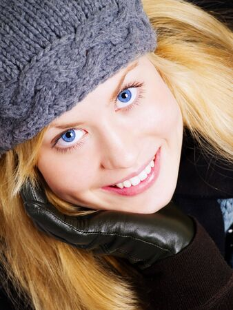 closeup of smiling blond woman in winter clothes photo