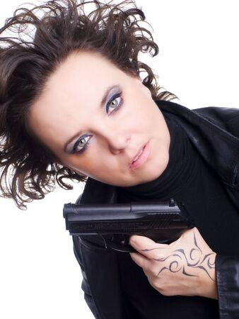 woman in leather wear holding gun over white background Stock Photo - 6296901