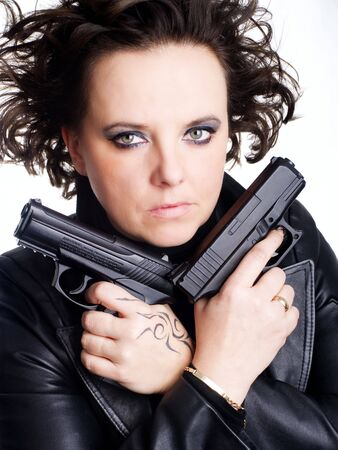 woman in leather wear holding two guns photo