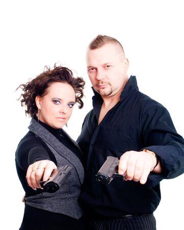 couple holding guns over white background photo