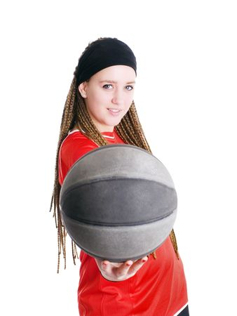 young sport woman holding ball over white background photo