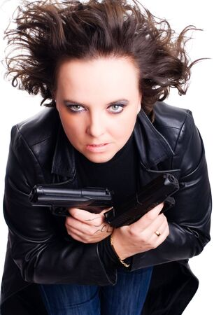 woman in leather wear holding gun over white background photo