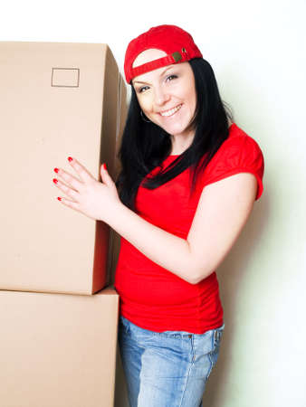 pretty woman picking up boxes while working Stock Photo - 6525048