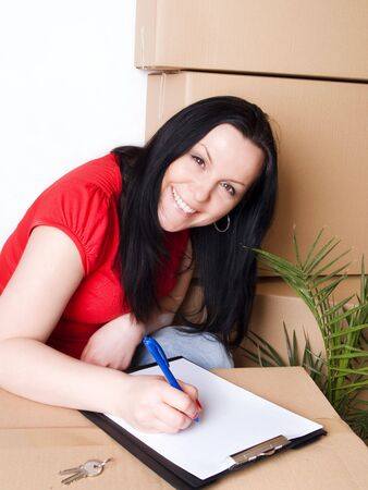 woman with package signs delivery paper Stock Photo - 6525049