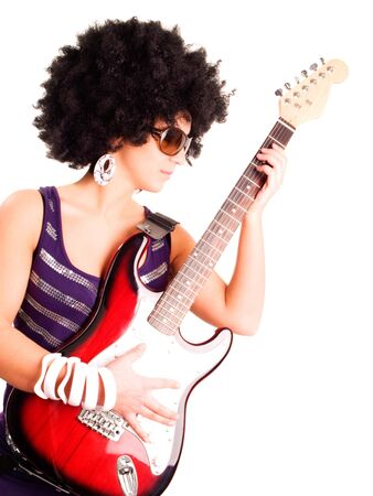 young guitarist girl holding guitar isolated over white background photo