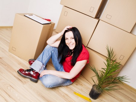 hypothec: young woman moving to new house  Stock Photo