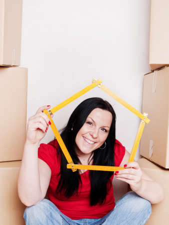 smiling woman with carton boxes holding measuring tape Stock Photo - 6998368
