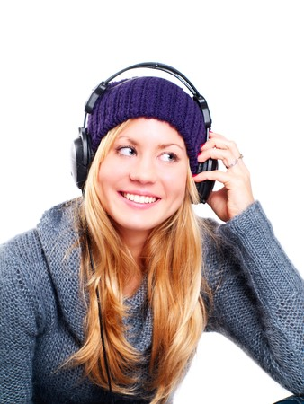smiling blond woman with headphones listening music over white photo