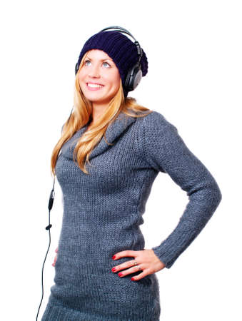 smiling blond woman with headphones listening music over white Stock Photo - 7131103