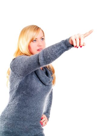 blond woman pointing by finger over white photo