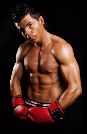 muscular man fighting box over dark background Stock Photo
