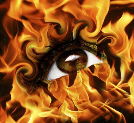 woman eyeball: abstract burn eye with fire  Stock Photo